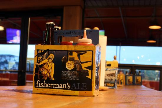 Cape Ann Brewing Company & Brewpub : Beer boxes holding the condiments on the tables.