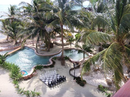 La Beliza Resort: Pool, Giant Chess Board and the Thatch Hut Bar below