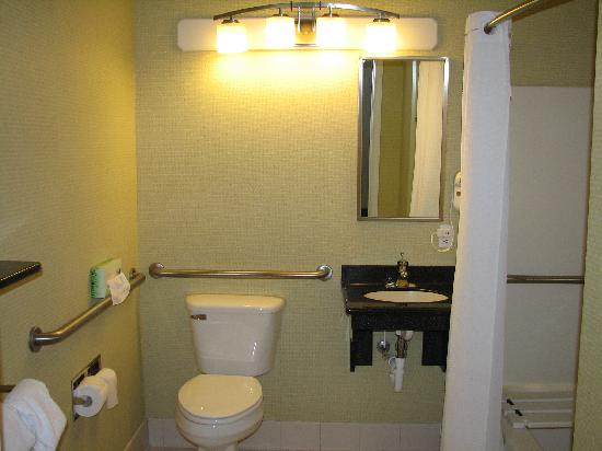 Holiday Inn Express Kent Island : Handicapped accessible bath with roll-in shower, fold-down shower seat, and adjustable showerhea