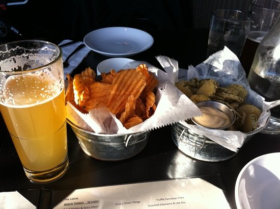 draft white beer, warm chips, and fried pickles at the Local