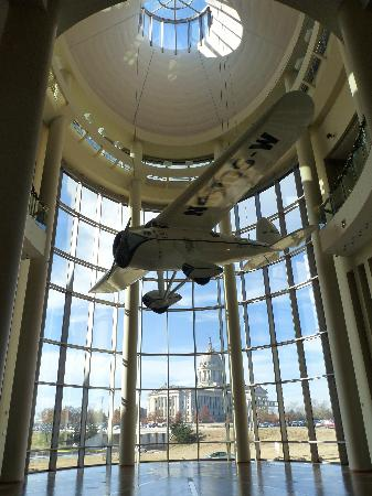 Oklahoma History Center: A replica of Wiley Post's airplane with the Capitol Building in the distance.