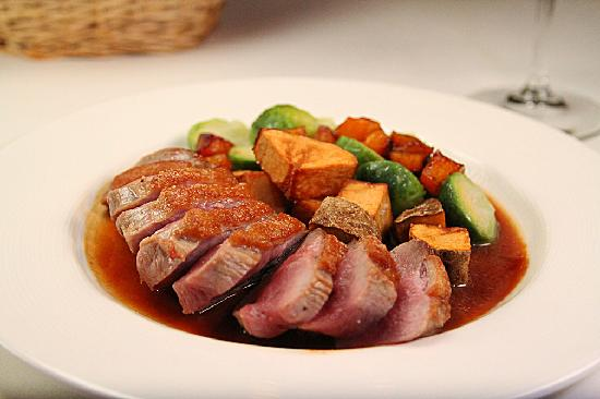 Blue Bicycle: Seared Duck Breast with an Apple Cider Reduction Sauce with Crisp Potatoes, Butternut Squash and