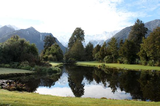 Reflection Lodge: View to Mt Tasman & Mt Cook reflected in the pond on the front lawn.