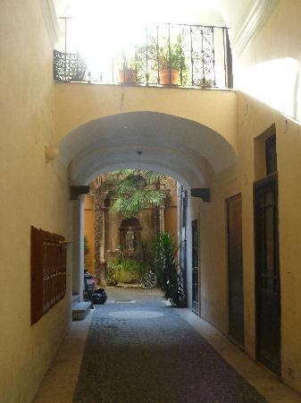 Pantheon Inn: After walking through a hidden wooden door you see this cute little courtyard.  Then take elevat