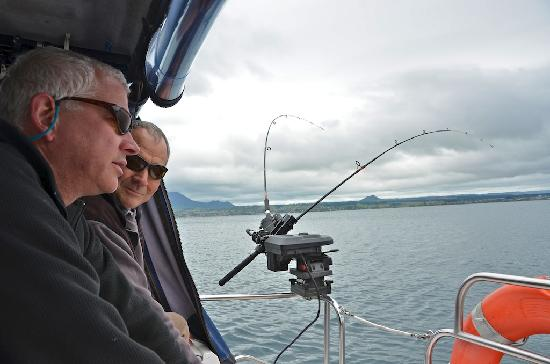 Above the Lake at Windsor Charters: Mate Gary and Tim discussing down rigger depth