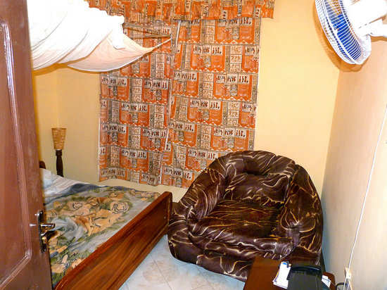 Giraffe Garden Hotel: What is it with Tanzanians and huge overstuffed furniture in small rooms?!