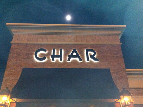 Char Restaurant: Exterior of Char, with full moon in background