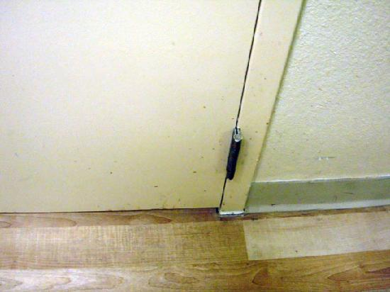 Extended Stay America - Atlanta - Morrow: sticky stuff splattered along baseboards and on doors