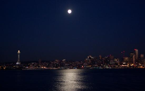Washington State Ferries: View of Seattle from the Ferry on a clear night with a full moon.