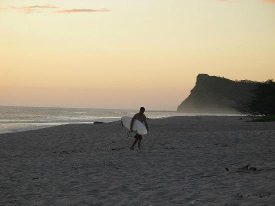Hacienda Iguana: Just before dusk.....one of two surfers playing in the surf