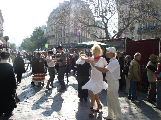 Rue Mouffetard Market: The lead dancers are dressed in white