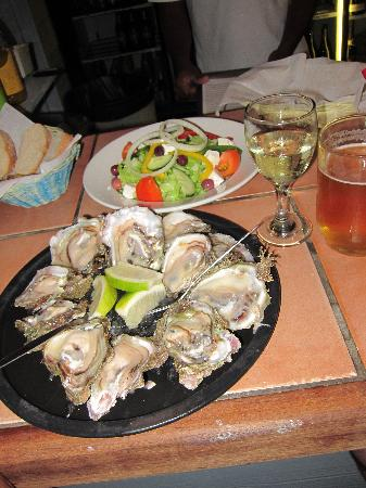 The Oyster Catcher: A dozen wild oysters and a glass of wine US$10