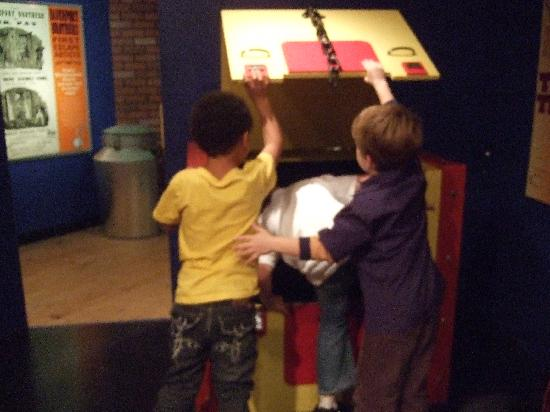 The History Museum at the Castle: Children playing the Metamorphosis trick in the A.K.A. Houdini exhibit.