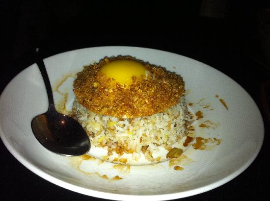 Spice Market: fried rice with egg on top garnished with crispy flakes of garlic