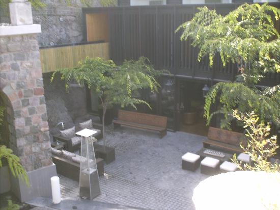 The Aubrey Boutique Hotel: Another view from our room of one of the outdoor spaces.