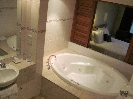 The Executive Inn: jetted tub and sliding doors into bedroom