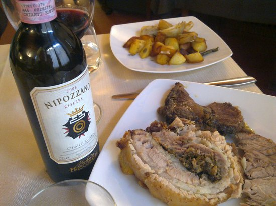 Da Ventura's mouthwatering three meat selection and a nice red!