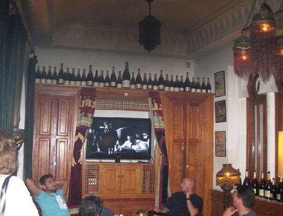 Rick's Cafe: Casablanca showing in Rick's bar