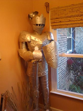 The Little English Guesthouse: A suit of armor in the lobby / sitting area