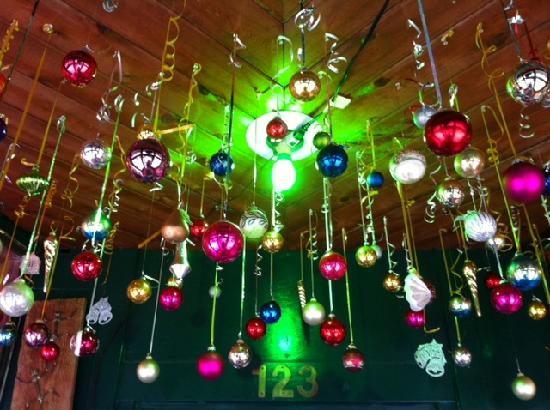 Christmas Decorations Hanging From The Ceiling As You Walk