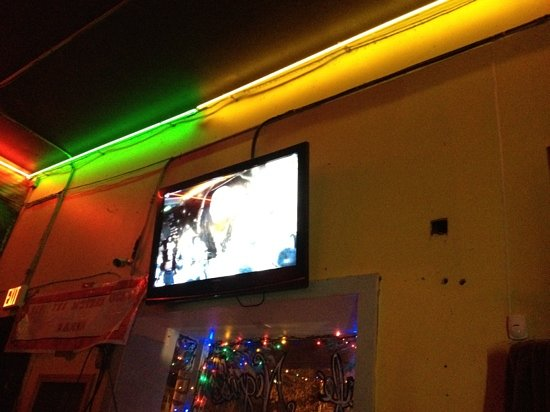 Cafe Negril: tv showing the band on stage