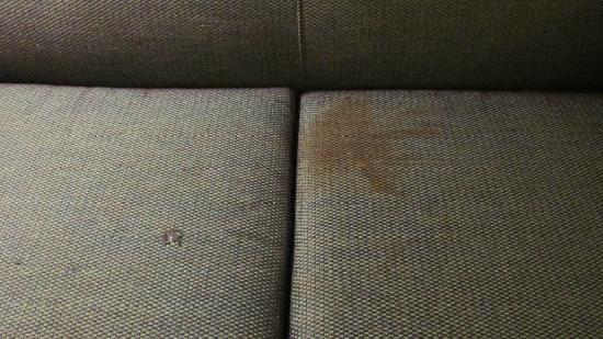 Americas Best Value Inn & Suites: Stained & holey sofa