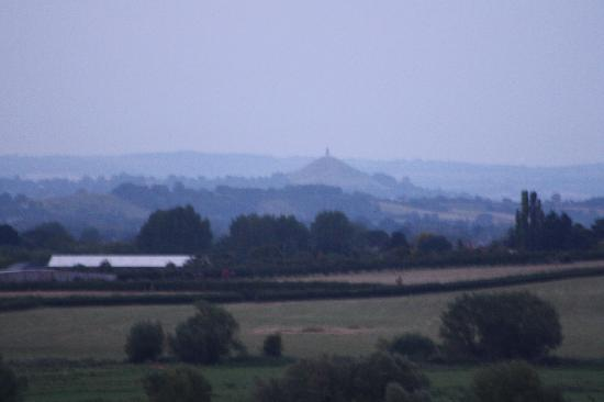 Burrow Mump: Blurred, but can still see Glastonbury Tor, rising up in the evening mist.
