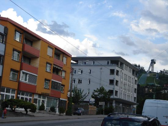 Pension Zillertal: Hotel Zillertal on Left with Olympic Ski Jump at right