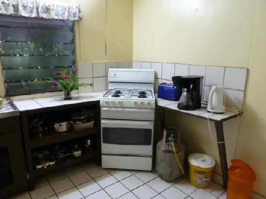Atiu Guesthouse: shared kitchen is complete with range, coffee maker, toast, electric kettle