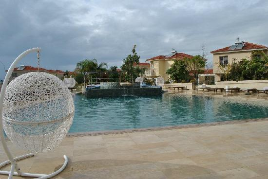 The Pool Side Picture Of E Hotel Spa And Resort Pervolia