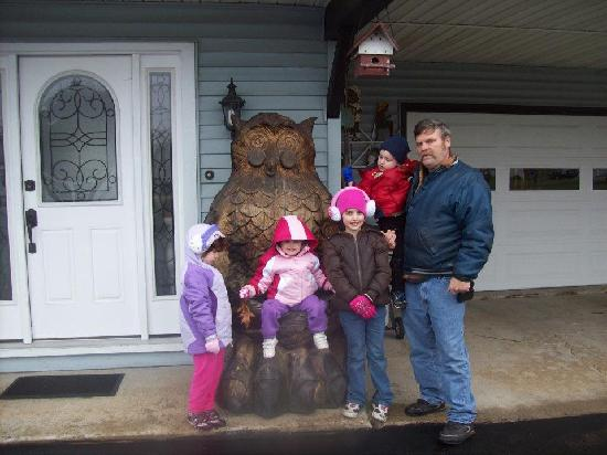Sleepy Time Motel: This was Pappy and our 4 grand kids on a cute owl carving outside the motel