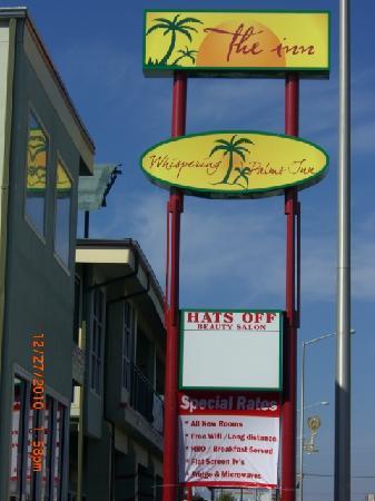 Whispering Palms Inn: WPI Sign