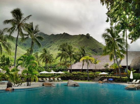 Hilton Moorea Lagoon Resort & Spa: A shot of the pool area. Yes, it looks a bit cloudy, but there are always clouds passing by on t