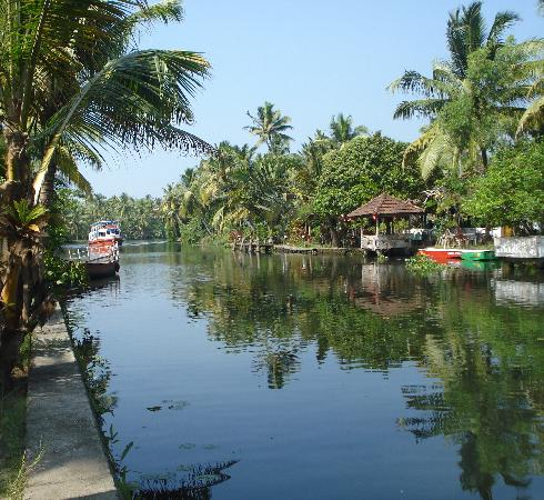 Coir Village Lake Resort: The canal with the restaurant on one bank and the rooms on the other