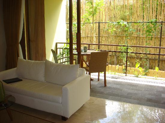 Komaneka at Rasa Sayang: sitting area and balcony
