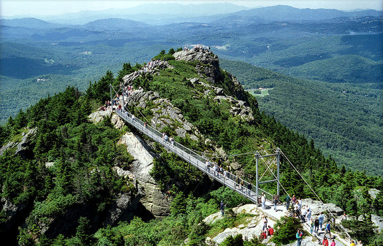Grandfather Mountain: The Mile High Swinging Bridge hangs 5,280 ft (1 mi.) above sea level and 80 ft. above the ground