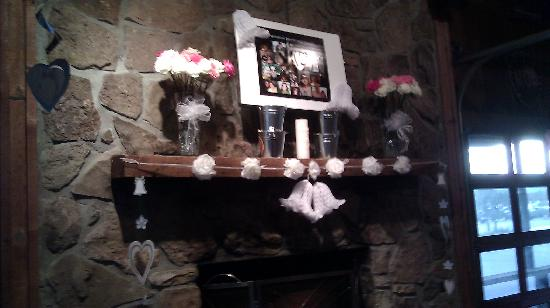 """Logan's Roadhouse: Mantle in the """"garage"""""""
