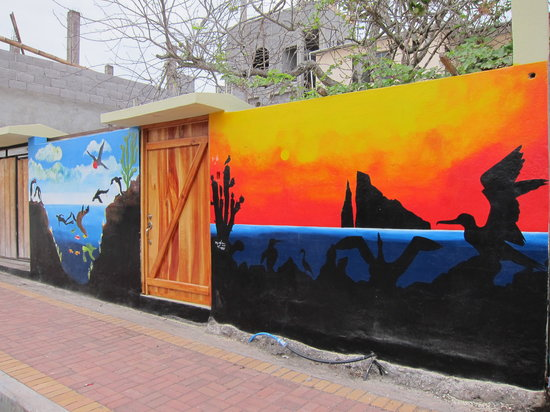 Los Pinquinos: No sign out front, but you'll recognize this mural
