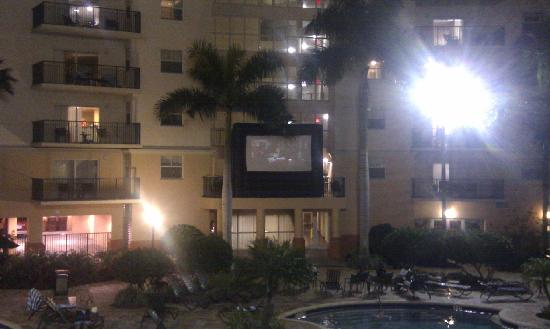 Wyndham Palm-Aire: Pool at night with 'cinema' screen
