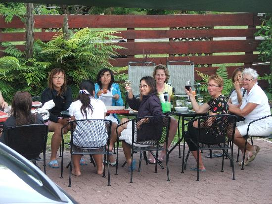 Tourist Court Motel: group dinner under the shade sail
