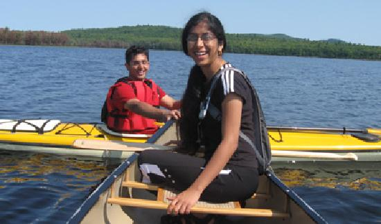 Nurture Through Nature Eco-cabin Rentals and Retreats: Guests on a guided day paddle