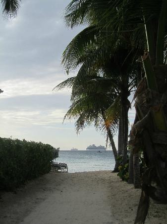 7 Mile Beach Resort and Club: View down beach access walkway.