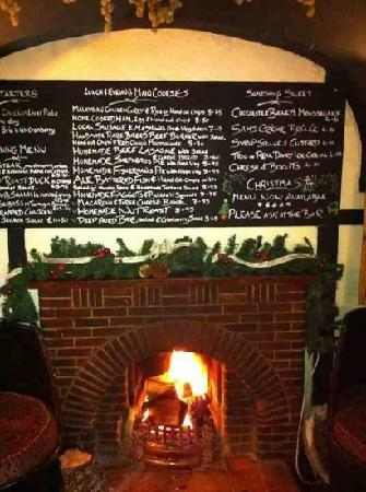 The Rose and Crown: menu above the fireplace