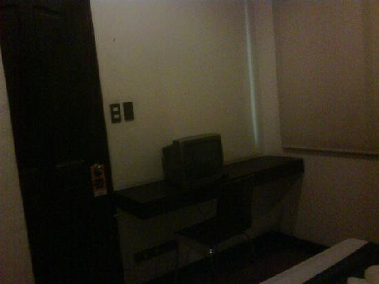 The Orange Place Hotel Quezon City: room a bit cramped but clean, no peephole, chain, or bolts for security