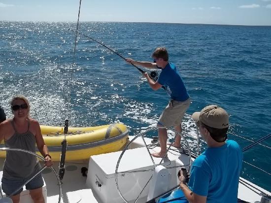 Adventure Sports Sailing : bringing in a tuna