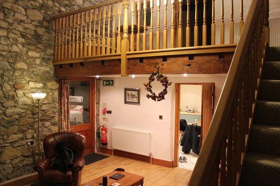 Joys of Life: Spacious living room with balcony.
