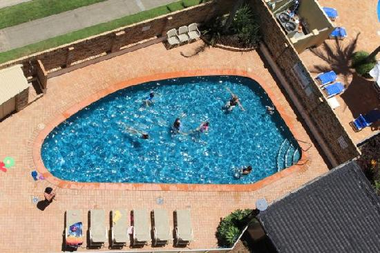 Rainbow Place: View of the private pool from the balcony of our apartment