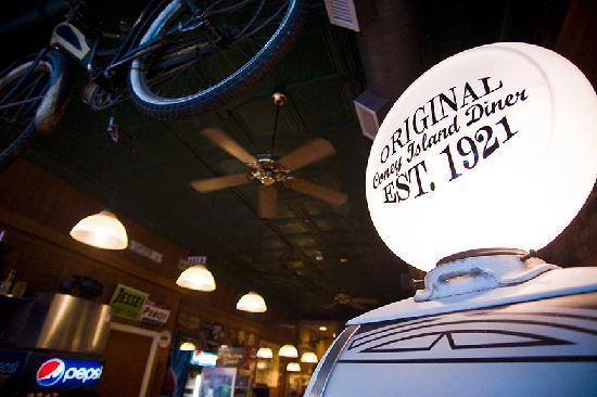 Coney Island The Original: Antique bike and gas pump