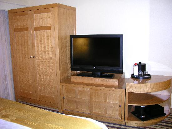 Renaissance Palm Springs Hotel: Wardrobe Closet, Dresser Cabinet And TV In  The Bedroom