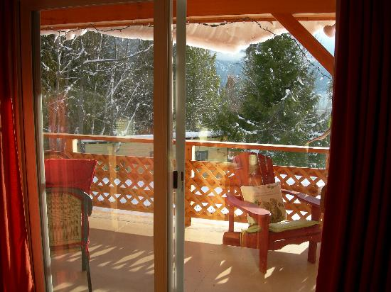 The Kaslo Bavarian Lodge: View from the living room of patio and beyond